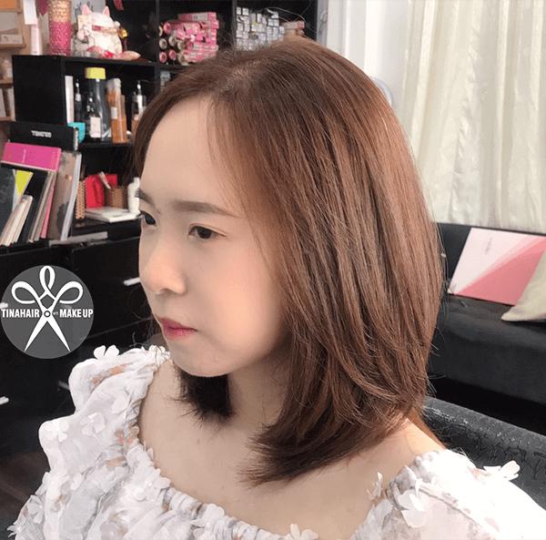 Cắt tóc tạo kiểu theo khuôn mặt và nhuộm nâu ánh đồng